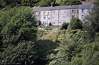 Pictured: Rear view of the affected houses with part of the landslip still visible. Thursday 31 August 2017<br /> Re: Home owners and tennants have been served to evacuation orders by Neath Port Talbot County Council over fears that a landslip has made their houses unsafe in Cyfyng Road, Ystalyfera, Wales, UK.