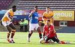27.09.2020 Motherwell v Rangers:  Trevor Carson saves at the feet of Alfredo Morelos