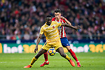 Michael Olunga Ogada (L) of Girona FC competes for the ball with Jose Maria Gimenez de Vargas of Atletico de Madrid  during the La Liga 2017-18 match between Atletico de Madrid and Girona FC at Wanda Metropolitano on 20 January 2018 in Madrid, Spain. Photo by Diego Gonzalez / Power Sport Images