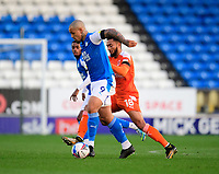 Blackpool's Grant Ward vies for possession with Peterborough United's Jonson Clarke-Harris<br /> <br /> Photographer Chris Vaughan/CameraSport<br /> <br /> The EFL Sky Bet League One - Peterborough United v Blackpool - Saturday 21st November 2020 - London Road Stadium - Peterborough<br /> <br /> World Copyright © 2020 CameraSport. All rights reserved. 43 Linden Ave. Countesthorpe. Leicester. England. LE8 5PG - Tel: +44 (0) 116 277 4147 - admin@camerasport.com - www.camerasport.com