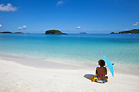 Alexa Putnam on the beach with parasol<br /> Cinnamon Bay<br /> Virgin Islands National Park<br /> St. John, U.S. Virgin Islands