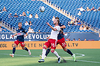 FOXBOROUGH, MA - JUNE 26: Alex Bruce #28 of North Texas SC battles Collin Verfurth #35 of the New England Revolution for a high ball during a game between North Texas SC and New England Revolution II at Gillette Stadium on June 26, 2021 in Foxborough, Massachusetts.