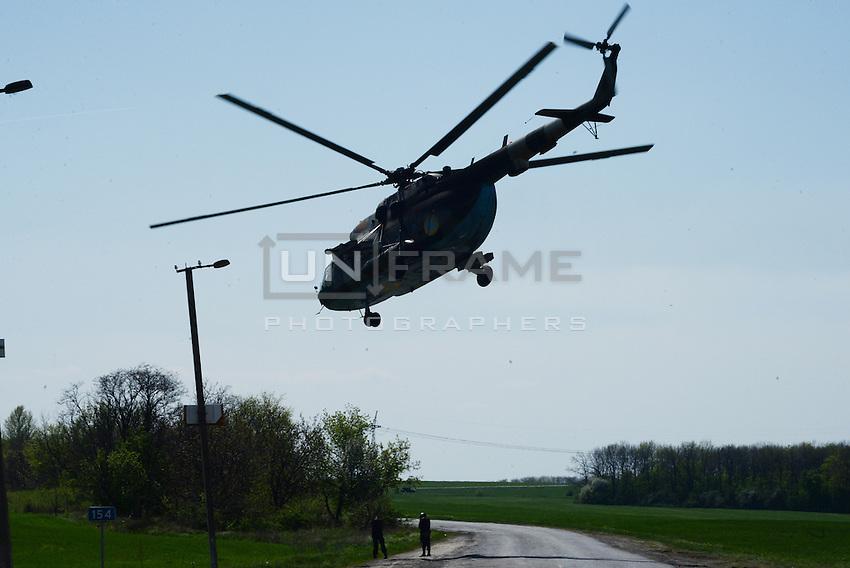 Ukrainian Helicopter at one of the check points surrounding rebelling city of Slavyansk. Ukraine. Donetsk  region