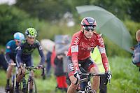Martin Elmiger (SUI/IAM) on the cobbles of sector 6: Bersée (1400m)<br /> <br /> 2014 Tour de France<br /> stage 5: Ypres/Ieper (BEL) - Arenberg Porte du Hainaut (155km)