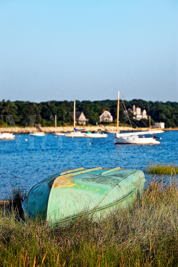 Overturned row boat on beach dune overlooking harbor, Pleasant Bay, Chatham, Cape Cod, MA, USA