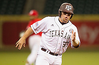 Texas A&M Aggie designated hitter Mitchell Nau #30 hustles towards third base against the Houston Cougars in the NCAA baseball game on March 1st, 2013 at Minute Maid Park in Houston, Texas. Houston defeated Texas A&M 7-6. (Andrew Woolley/Four Seam Images).
