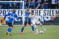 SAN JOSE, CA - MAY 15: Jackson Yueill #14 of the San Jose Earthquakes battles Marvin Loria #44 of the Portland Timbers for the ball during a game between San Jose Earthquakes and Portland Timbers at PayPal Park on May 15, 2021 in San Jose, California.