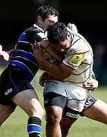 Photo: Richard Lane/Richard Lane Photography. Bath Rugby v London Wasps. Aviva Premiership. 21/04/2012. Wasps' Billy Vunipola is tackled by Bath's Stephen Donald.