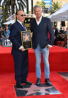 LOS ANGELES, CA. October 10, 2019: Tommy Mottola & David Foster at the Hollywood Walk of Fame Star Ceremony honoring Tommy Mottola.<br /> Pictures: Paul Smith/Featureflash