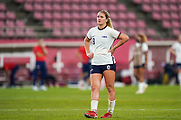 KASHIMA, JAPAN - AUGUST 2: Lindsey Horan #9 of the United States dejected and in tears after their loss after a game between Canada and USWNT at Kashima Soccer Stadium on August 2, 2021 in Kashima, Japan.