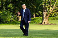 United States President Donald J. Trump waves he walks on the South Lawn of the White House after arriving on Marine One in Washington, D.C., U.S., on Sunday, June 14, 2020.  Trump tweeted that he will not watch the NFL or the U.S. Soccer Federation if either organization allows players to kneel during the playing of the American National Anthem.  <br /> Credit: Stefani Reynolds / Pool via CNP/AdMedia