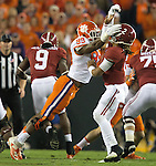 Clemson defensive end Clelin Ferrell is penalized 15 yards for roughing  Alabama quarterback Jalen Hurts in the first half of the 2017 College Football Playoff National Championship in Tampa, Florida on January 9, 2017.  Photo by Mark Wallheiser/UPI