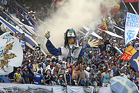 BOGOTA -COLOMBIA. 09-02-2014. Seguidores de Millonarios alientan su equipo  contra Nacional   partido por la cuarta fecha de La liga Postobon 1 disputado en el estadio El Campin. /  Followers of Millonarios encourage his team against the Atletico Nacional National Party's fourth date Postobon one league match at El Campin Stadium. Photo: VizzorImage/ Felipe Caicedo / Staff
