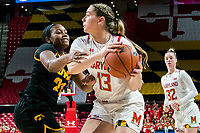 COLLEGE PARK, MD - FEBRUARY 13: Faith Masonius #13 of Maryland holds the ball away from Zion Sanders #21 of Iowa during a game between Iowa and Maryland at Xfinity Center on February 13, 2020 in College Park, Maryland.