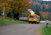 AJ1988, school bus, Vermont, fall, A school bus drives up a country road carrying school children in the autumn in South Walden.