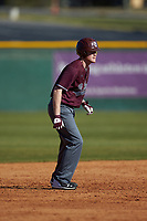 Chance Davis (18) of the Concord Mountain Lions takes his lead off of second base against the Wingate Bulldogs at Ron Christopher Stadium on February 2, 2020 in Wingate, North Carolina. The Mountain Lions defeated the Bulldogs 12-11. (Brian Westerholt/Four Seam Images)