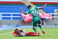 CALI - COLOMBIA, 04-04-2021: Amaury Torralvo de Equidad disputa el balón con Yesus Cabrera del América durante partido por la fecha 17 como parte de la Liga BetPlay DIMAYOR 2021 entre América de Cali y La Equidad jugado en el estadio Pascual Guerrero de la ciudad de Cali. / Amaury Torralvo of Equidad struggles the ball with Yesus Cabrera of America during match for the date 17 as part of BetPlay DIMAYOR League 2021 between America de Cali and La Equidad played at Pascual Guerrero stadium in Cali city. Photos: VizzorImage / Nelson Rios / Cont.