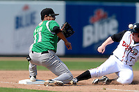 Dayton Dragons shortstop Humberto Valor (11) takes a throw as Chris Hawkins (7) slides in during a game against the Lansing Lugnuts on August 25, 2013 at Cooley Law School Stadium in Lansing, Michigan.  Dayton defeated Lansing 5-4 in 11 innings.  (Mike Janes/Four Seam Images)