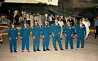 Crew after landing, Space Shuttle  Atlantis, STS 106 Mission, September 2000, Kennedy Space Center, Titusville, FL.  Crew:  Commander Terrence W. Wilcutt, Pilot Scott D. Altman, Mission Specialists Daniel C. Burbank, Edward T. Lu, Richard A. Mastracchio, Yuri I. Malenchenko and Boris V. Morokov.  (Photo by Brian Cleary/bcpix.com)