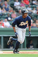 Outfielder Yeicok Calderon (25) of the Charleston RiverDogs in a game against the Greenville Drive on Sunday, May 19, 2013, at Fluor Field at the West End in Greenville, South Carolina. Charleston won, 9-7. (Tom Priddy/Four Seam Images)