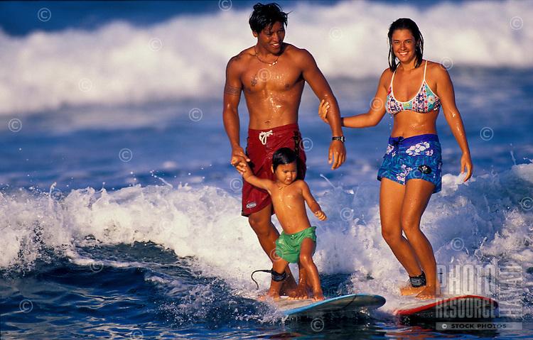 Hawaiian family surfing together on the Big Island