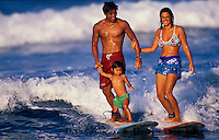 Hawaiian family surfing together on the Big Island