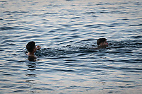 CEUTA, SPAIN ‐ MAY 19: Two young people try to swim across the border from Morocco to Spain, bordering the Tarajal beach on May 19, 2021 in Ceuta, Spain.  After a diplomatic conflict between Spain and Morocco, thousands of migrants who have taken advantage of the little Moroccan police activity on the border to cross it mainly by swimming, which has caused a migration crisis with the entry of more than 8000 migrants from the African country. (Photo by Joan Amengual/VIEWpress )