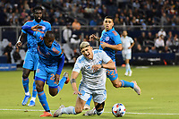 KANSAS CITY, KS - MAY 29: Alan Pulido #9 Sporting KC is fouled in the Dynamo penalty area during a game between Houston Dynamo and Sporting Kansas City at Children's Mercy Park on May 29, 2021 in Kansas City, Kansas.