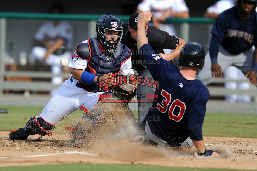 Tennessee Smokies catcher Rafael Lopez #29 attempts to field the ball and place a tag on Brock Kjeldgaard #30 as he slides in safely during game one of a double header against the Huntsville Stars at Smokies Park on July 8, 2013 in Kodak, Tennessee. The Stars won the game 2-0. (Tony Farlow/Four Seam Images)