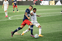 FOXBOROUGH, UNITED STATES - AUGUST 20: Gustavo Bou #7 of New England Revolution attempts to cross towards the goal with Raymon Gaddis #28 of Philadelphia Union defending during a game between Philadelphia Union and New England Revolution at Gilette on August 20, 2020 in Foxborough, Massachusetts.