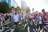 Santa Clara, CA - Friday June 3, 2016: USA fans carry a cutout of a crying James Rodriguez while walking to the stadium before the game.USA played Colombia in the opening match of the Copa América Centenario game at Levi's Stadium.