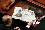 Sen. Edward D. Maloney, D-Chicago, left, looks at a newspaper article about Gov. Rod Blagojevich before the start of the fourth and last day of the governor's Senate trial at the State capitol in Springfield, Ill., on January 29, 2009.