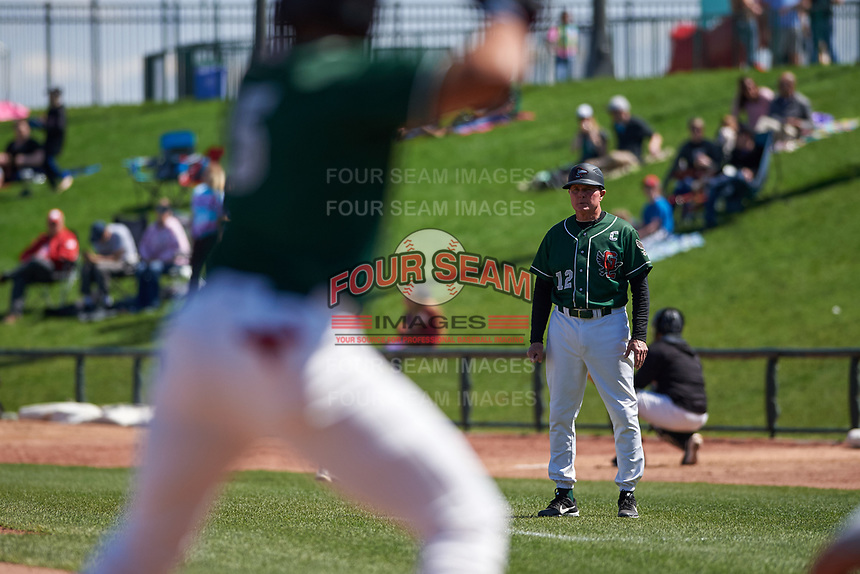Great Lakes Loons manager John Shoemaker (12) coaches first base during a Midwest League game against the Wisconsin Timber Rattlers at Dow Diamond on May 4, 2019 in Midland, Michigan. Great Lakes defeated Wisconsin 5-1. (Zachary Lucy/Four Seam Images)