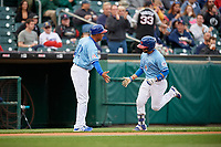 Buffalo Bisons manager Bob Meacham (12) congratualtes Raffy Lopez (43) after hitting a home run during a game against the Pawtucket Red Sox on May 19, 2017 at Coca-Cola Field in Buffalo, New York.  Buffalo defeated Pawtucket 7-5 in thirteen innings.  (Mike Janes/Four Seam Images)