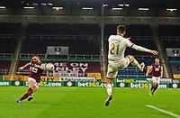 9th January 2021; Turf Moor, Burnley, Lanchashire, England; English FA Cup Football, Burnley versus Milton Keynes Dons; Phillip Bardsley of Burnley crosses the ball as Daniel Harvie of MK Dons attempts to block