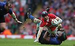 Thierry Dusautoir hauls down Leigh Halfpenny..RBS 6 Nations 2012.Wales v France.Millennium Stadium.17.03.12..CREDIT: STEVE POPE-SPORTINGWALES