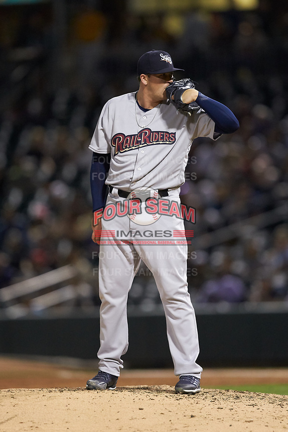 Scranton/Wilkes-Barre RailRiders relief pitcher Jonathan Holder (21) looks to his catcher for the sign against the Charlotte Knights at BB&T BallPark on April 12, 2018 in Charlotte, North Carolina.  The RailRiders defeated the Knights 11-1.  (Brian Westerholt/Four Seam Images)
