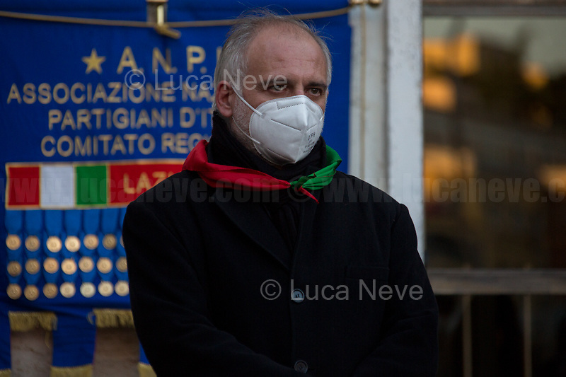 Fabrizio De Sanctis, President of ANPI of Rome (ANPI National Association of WWII Italian Partizans). <br /> <br /> Rome, Italy. 24th Mar, 2021. Today, Citizens of Rome, Antifascists, various organizations, Institutions and the President of the Italian Republic, Sergio Mattarella, pay tribute to the victims of the Fosse Ardeatine massacre in which, 77 years ago, on the 24th March 1944, 335 people were assassinated by the nazi-fascist occupation troupes in Rome. It was one of the most atrocious massacre perpetrated during World War II for retaliation against the Resistance and the Civilians.    <br /> <br /> Footnotes & Links:<br /> (Source, Treccani.it ITA) http://bit.do/fPZXL <br /> (Source, Jewishvirtuallibrary.org ENG) http://bit.do/fPZXu<br /> (Source, Wikipedia.org ENG) http://bit.do/fPZXW <br /> Today's Events: https://www.facebook.com/events/4526526500707783/ & https://www.facebook.com/events/1096587897511737/