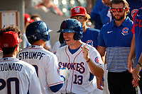 Tennessee Smokies first baseman Jared Young (13) is all smiles in the dugout during the game against the Rocket City Trash Pandas at Smokies Stadium on July 2, 2021, in Kodak, Tennessee. (Danny Parker/Four Seam Images)