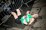 © Joel Goodman - 07973 332324 . 10/04/2016 . Manchester , UK . Race runners at the finishing line of the 40th Greater Manchester Marathon . Photo credit : Joel Goodman