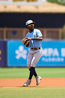 Tampa Bay Rays shortstop Osleivis Basabe (83) throws to first base during a Minor League Spring Training game against the Atlanta Braves on June 1, 2021 at Charlotte Sports Park in Port Charlotte, Florida.  (Mike Janes/Four Seam Images)