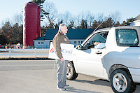 A campaign volunteer speaks to an attendee leaving while taking down campaign signs after Texas senator and Republican presidential candidate Ted Cruz spoke at a town hall at Crossing Life Church in Windham, New Hampshire, on Tues. Feb. 2, 2016. The day before, Cruz won the Iowa caucus.