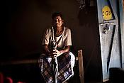 Varse Malla from the Dorna tribe poses for a portrait inside his small empty hut in  Dornapal, a Salwa Judum village in Chattisgarh, India. Photo: Sanjit Das/Panos for Forbes