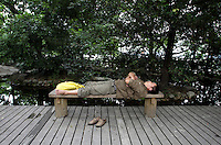 "A man sleeps in the ""Living Water Garden"" in Chengdu, Sichuan Province. The garden is a park aimed at highlighting the importance of the relationship between man and water. 2010"