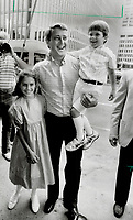 1984 FILE PHOTO - ARCHIVES -<br /> <br /> Day out: Progressive Conservative leader Brian Mulroney with son Mark, 5, and daughter Caroline, 10, arrives for yesterday's meeting in Montreal to unveil names of candidates running in Quebec. Mulroney has accused the Liberals of stealing Tory energy policies.<br /> <br /> 1984<br /> <br /> PHOTO :  Collin McConnell - Toronto Star Archives - AQP