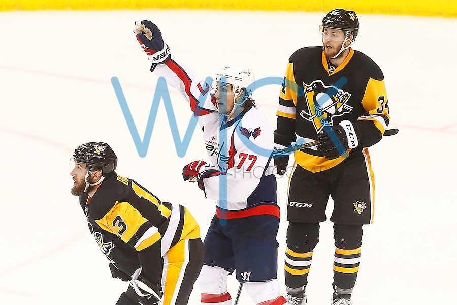 T.J. Oshie #77 of the Washington Capitals signals for a penalty by Nick Bonino #13 of the Pittsburgh Penguins in the third period during game six of the second round of the Stanley Cup Playoffs at Consol Energy Center in Pittsburgh, Pennsylvania on May 10, 2016. (Photo by Jared Wickerham / DKPS)