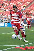FC Dallas forward Kenny Cooper (33) takes control of the ball on the touchline. Real Salt Lake vs FC Dallas at Pizza Hut Park Frisco, Texas May-24-2008 Final Score 1-2