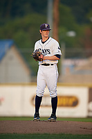 Princeton Rays starting pitcher Stephen Yancey (15) gets ready to deliver a pitch during the second game of a doubleheader against the Johnson City Cardinals on August 17, 2018 at Hunnicutt Field in Princeton, Virginia.  Princeton defeated Johnson City 12-1.  (Mike Janes/Four Seam Images)