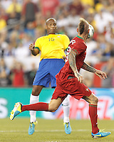 Portugal midfielder Raul Meireles (16) intercepts chest trap back to the goalkeeper and scores. In an international friendly, Brazil (yellow/blue) defeated Portugal (red), 3-1, at Gillette Stadium on September 10, 2013.