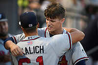 Designated hitter Bryce Ball (45) of the Rome Braves hugs pitcher Kasey Kalich (61) before a game against the Columbia Fireflies on Saturday, August 17, 2019, at Segra Park in Columbia, South Carolina. Rome won, 4-0. (Tom Priddy/Four Seam Images)